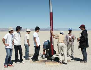 Students helping adjust launcher